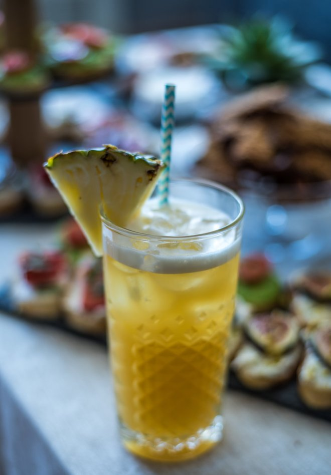 A special homemade welcome cocktail made with dark rum, spiced rum, amaro, lime juice, simple syrup, pineapple juice and orange juice.