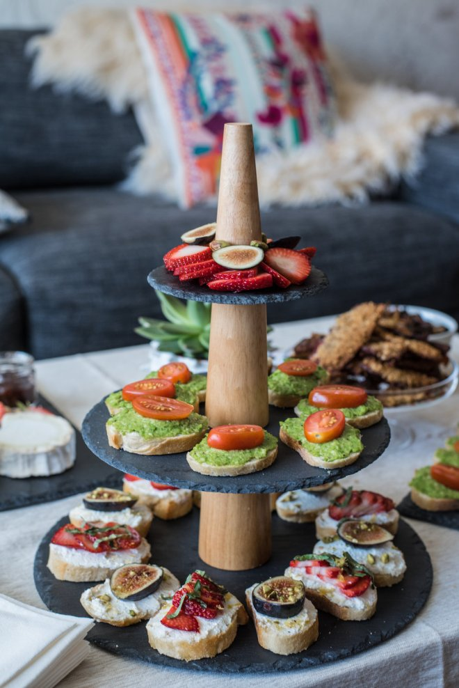 A little tower of crostini: pea pesto with baby tomatoes, ricotta with lemon zest, strawberries, basil and honey, and ricotta with figs, pistachio and honey.