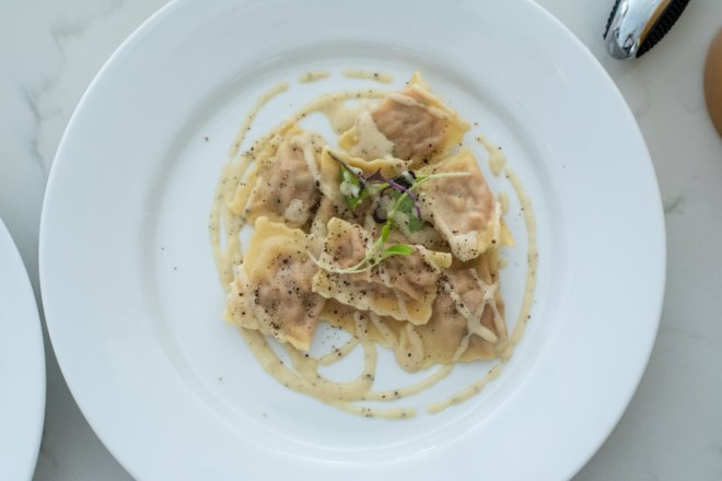 These little ravioli pack a serious punch. The squeeze bottle and microgreens take this dish from deliciously homemade to top restaurant quality.