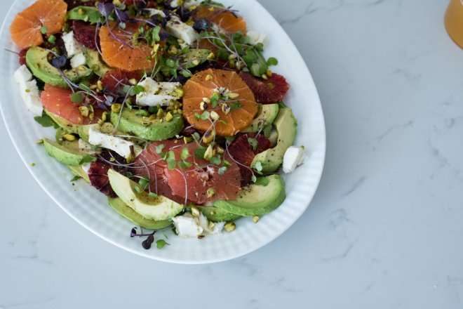 While my guests settled in and enjoyed their first appetizers, I threw together a quick salad of oranges, blood oranges, grapefruit, avocado, arugula, microgreens, fresh mozzarella, pistachios and lemon zest. I had prepared the fruit in advance by removing all of the skin and slicing it into rounds. A quick dressing can also be made in advance - mine was a citrus wildflower honey vinaigrette with a little bit of balsamic vinegar that I brought back from my trip to Italy last year.